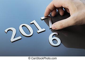 Happy New Year 2017 - Man making number 2017 using metallic...