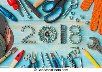 Happy new year 2018 composition with screws, nails, bolts , ...