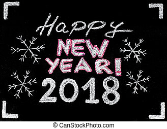 Happy new year 2018, hand writing with chalk on blackboard, vintage concept