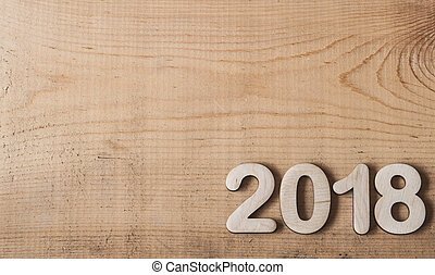 Happy new year 2018, Number wood material on wooden table.