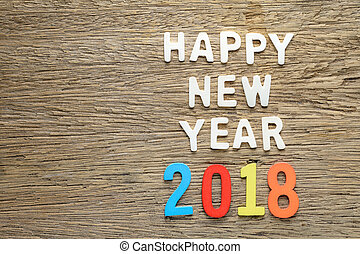 Happy new year 2018 words on wooden background