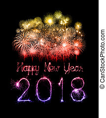 Happy new year 2018 written with Sparkle firework at night