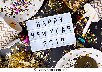Happy new year 2019 on light box with party cup,party...