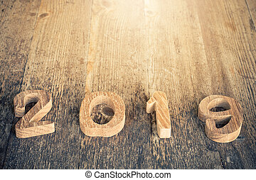 happy new year 2019 on wooden background.