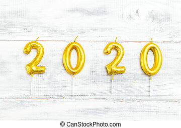 Happy New Year 2020. Number 2020 on whire wooden background