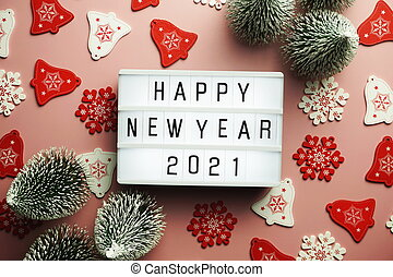Happy New Year 2021 word in light box on pink background
