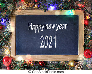 happy new year 2021 writing on a slate in christmas ornament