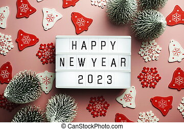 Happy New Year 2023 word in light box on pink background