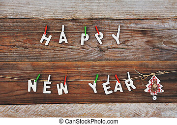 happy new year and christmas tree on wooden background