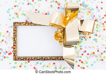 Happy new year blank frame with golden ribbon and confetti