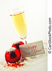 Happy New Year card. White wine and christmas balls with ...