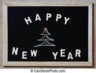 happy new year christmas tree on blackboard
