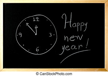 happy new year clock is written on a blackboard