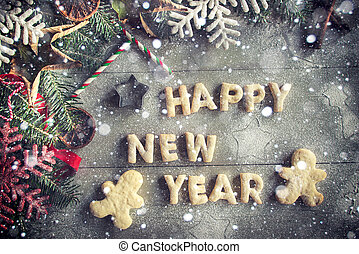 Happy New Year cookies on wooden background