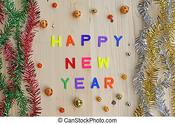 Happy new year decoration on brown wooden background