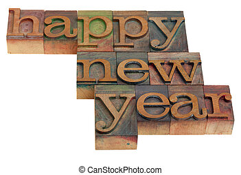 Happy New Year greetings in vintage wooden letterpress...