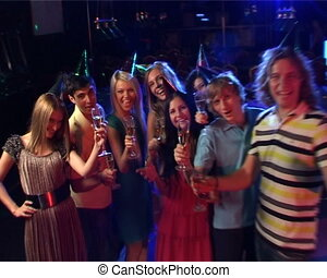 Happy New Year! - Group of young happy people celebrating...