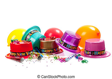 New Year's hats, noise makers, streamers, balloons and confetti on a white background