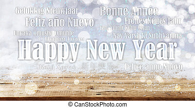 Happy new year in many languages on snowy background