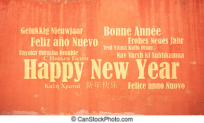 Happy new year in many languages on stucco painted wall background