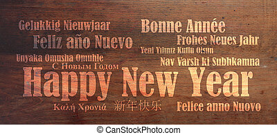 Happy new year in many languages on wooden background