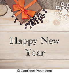 Happy New Year inscription on a wooden background