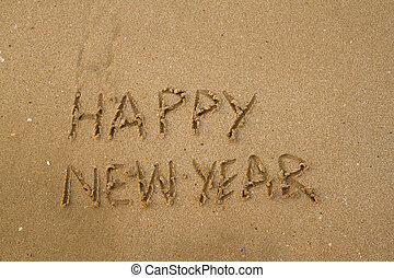 Happy New Year Message on Sand