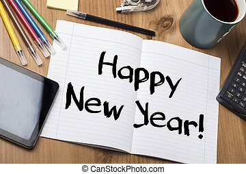 Happy New Year! - Note Pad With Text On Wooden Table