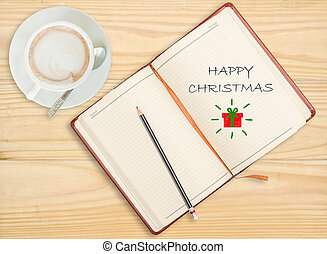 """""""Happy New year"""" on notebook with pencil and coffee cup on woode"""