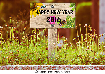 happy new year signpost in beautiful woodland with vintage floral meadow filter