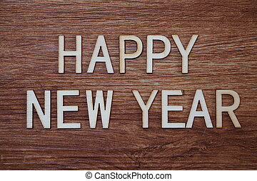Happy New Year text message on wooden background