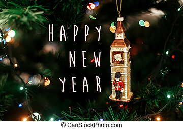 happy new year text sign on Queen's guard near big ben christmas ornament, cute toy soldier near golden watch clock english christmas decoration close-up, surrounded by colorful lights