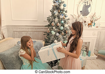 Happy new year. Winter. Christmas tree and presents. xmas online shopping. Family holiday. The morning before Xmas. Little girls. Child enjoy the holiday. Sincere congratulations