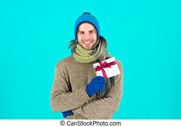Happy new year. Winter holidays celebration. Christmas present. Man with present box. Shopping. The morning before Xmas. Christmas composition. Merry Christmas and Happy Holidays