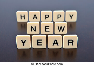 Happy New Year word formed by letter pieces