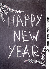 Happy New Year written in white chalk on a chalkboard