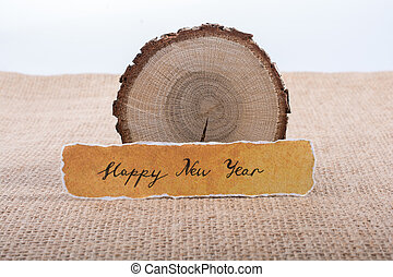 Happy new year written on a torn paper - Happy new year...
