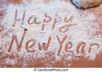Happy New Year written on the flour,