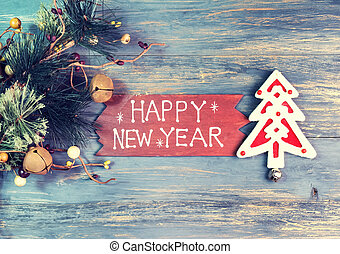 happy new year written on wooden background with snowflake