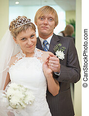 Happy newly-married couple - a smart portrait in a solemn...