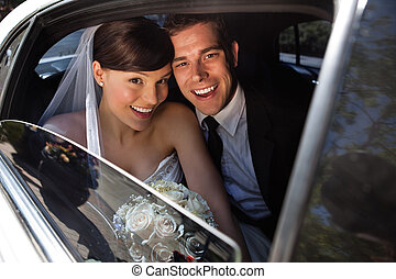 Happy newly wed couple - Portrait of happy newly wed couple...