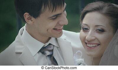 Happy newlyweds, gentle kiss closeup