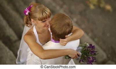 Happy newlyweds on nature - Happy newlyweds hugging on...