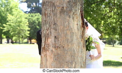 Happy newlyweds posing in the park