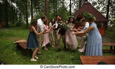 Happy newlyweds their guests nature