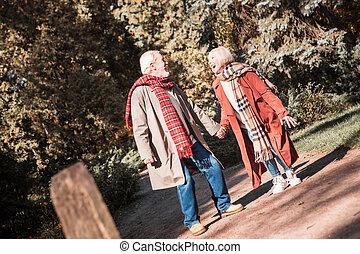 Happy nice aged couple having a romantic walk