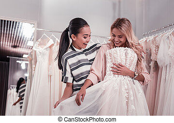 Happy nice women finding a wedding dress - Perfect choice....