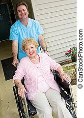 Happy Nursing Home Resident - Happy senior woman at a...
