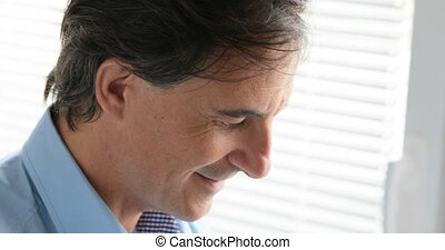 office worker typing on laptop - up left to bottom right pan