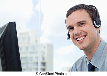 Happy office worker using a headset